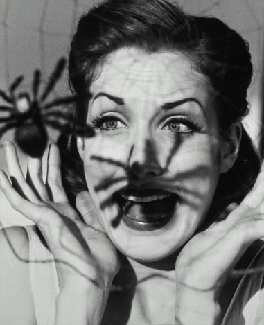 frightened woman's face because of a spider