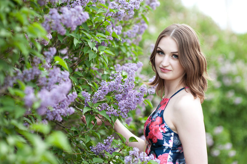 Kayla holding lilac bloom Calgary portrait photography by Tara Whittaker