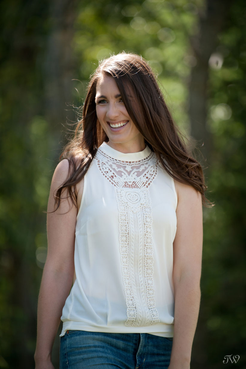 bride smiles during engagement pictures with Tara Whittaker Photography