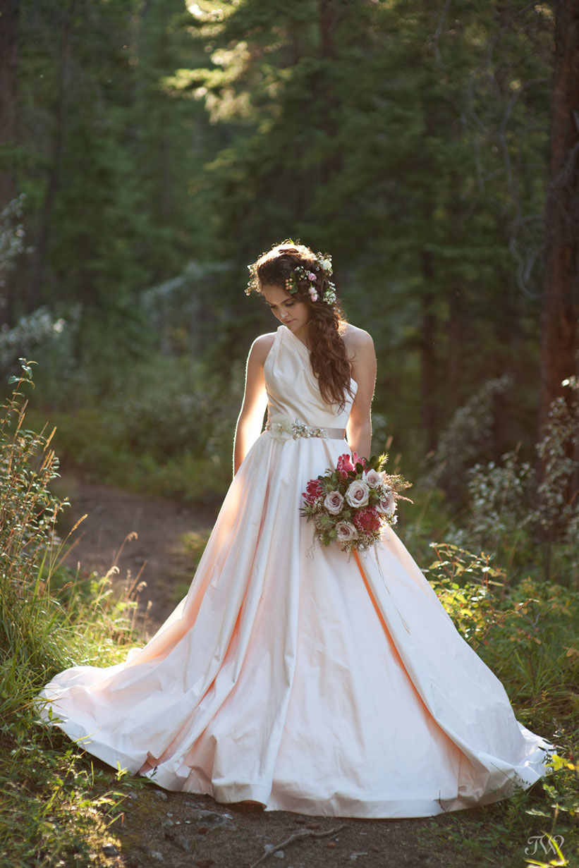 Rocky Mountain bride wearing a blush Romona Keveza gown captured by Calgary wedding photographer Tara Whittaker