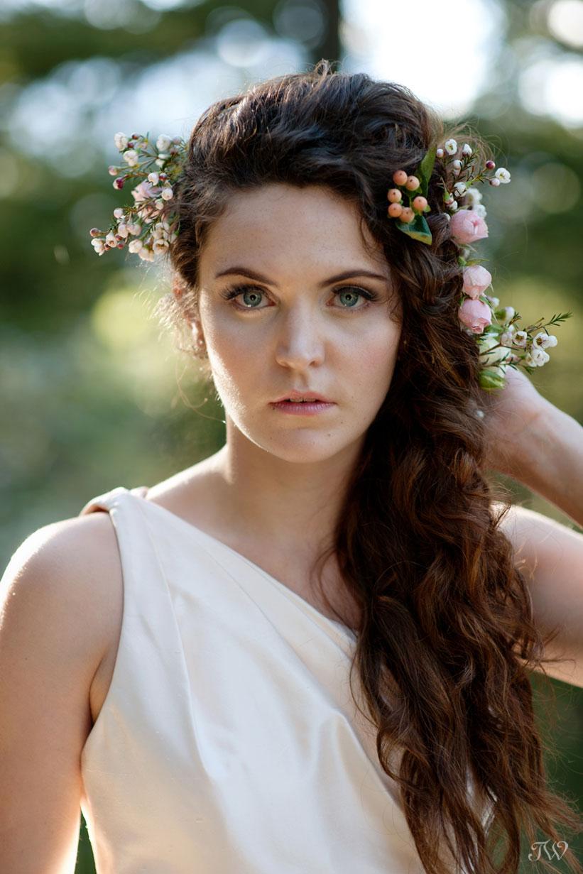 Rocky Mountain bride wearing flowers in her hair captured by Calgary wedding photographer Tara Whittaker