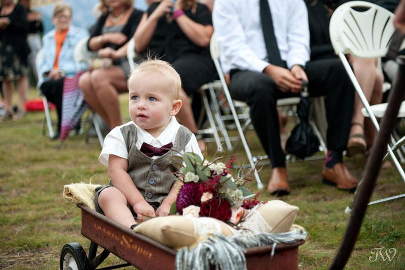 cute ringbearer at Quarry Lake wedding in Calgary captured by Tara Whittaker