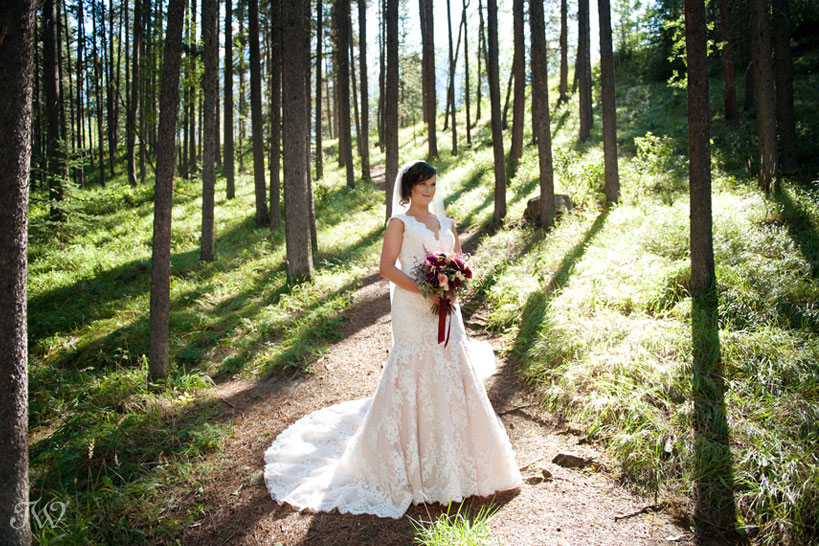 Bride poses after her Quarry Lake wedding in Canmore