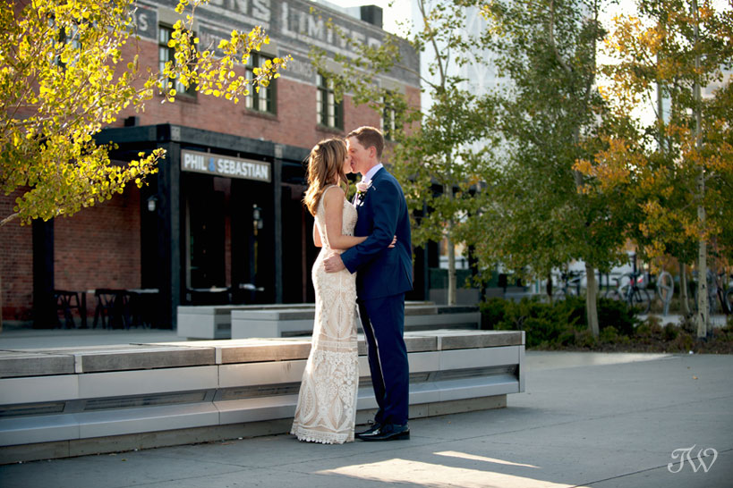 Bride and groom kiss before their Charbar Calgary wedding captured by Tara Whittaker Photography
