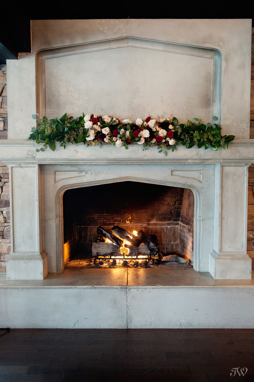 fireplace at a Lake House wedding captured by Calgary wedding photographer Tara Whittaker