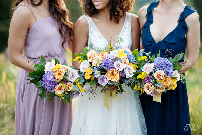 beautiful bridal bouquets at a Silvertip wedding captured by Calgary wedding photographer Tara Whittaker