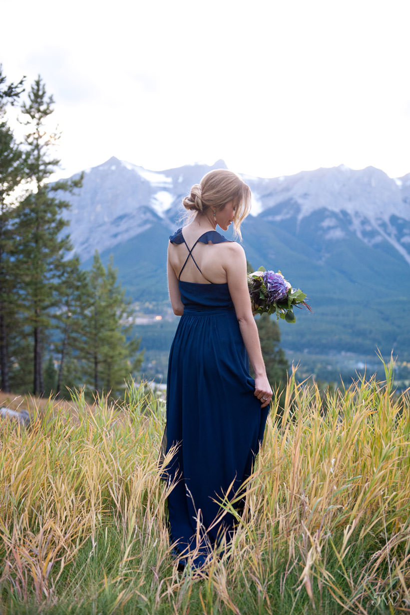 fall bridesmaid in Joanna August at a Silvertip wedding captured by Calgary wedding photographer Tara Whittaker