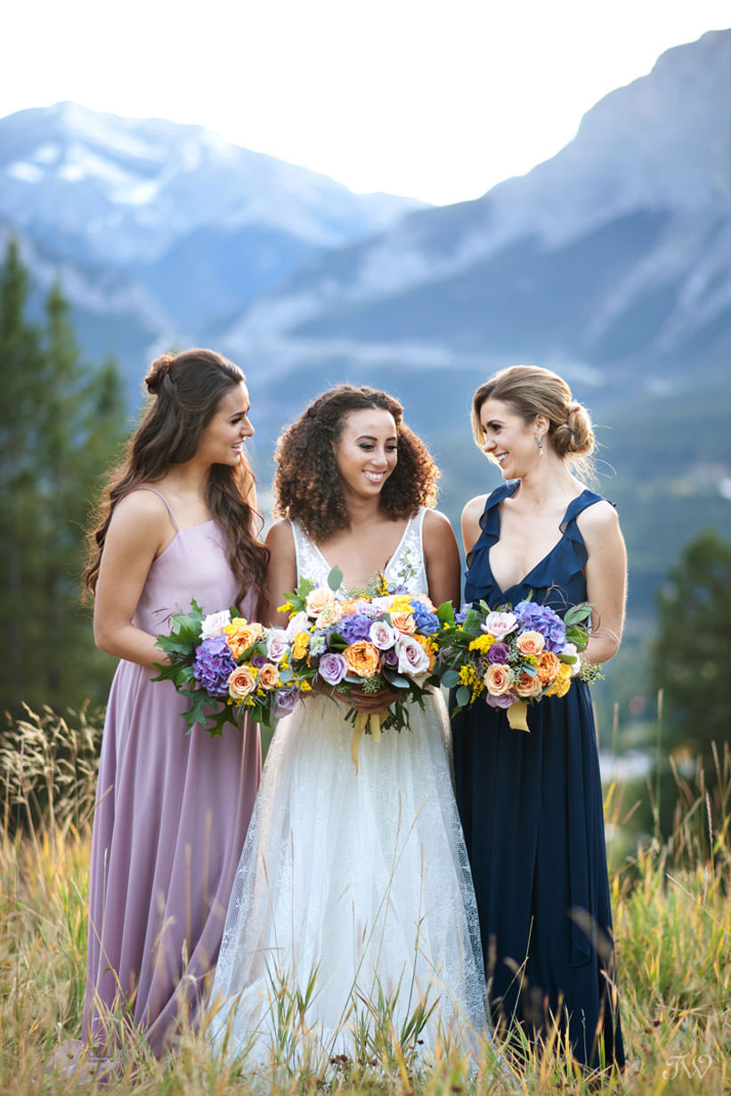 Bridal party carry Ultra violet flowers captured by Tara Whittaker Photography
