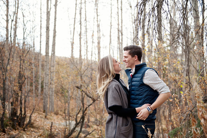 Happy couple during their Big Hill Springs engagement session captured by Tara Whittaker Photography