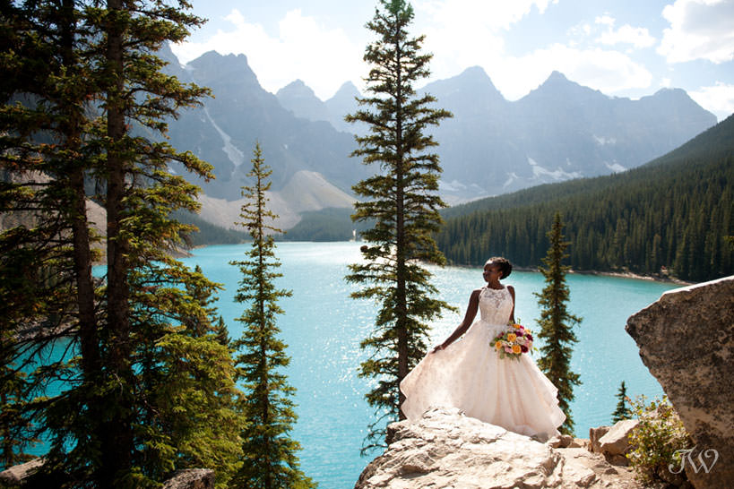 Moraine Lake bride Debol carries a bouquet from Flowers by Janie captured by Tara Whittaker Photography