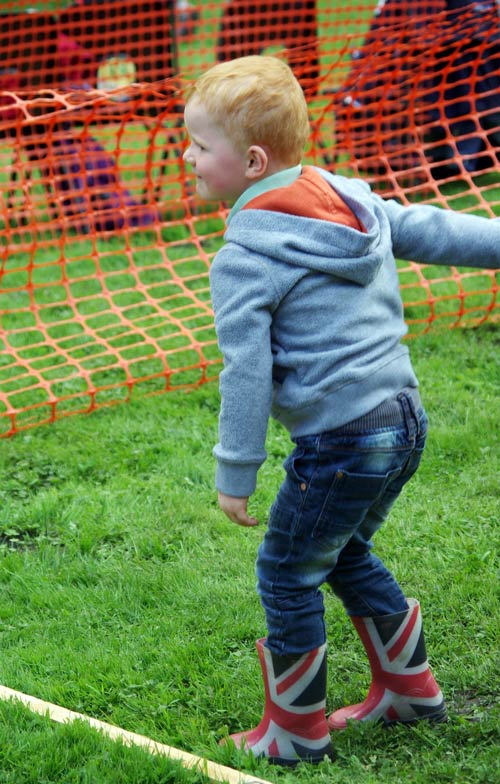 Young visitor trying the coconut shy Fair and Show 2015