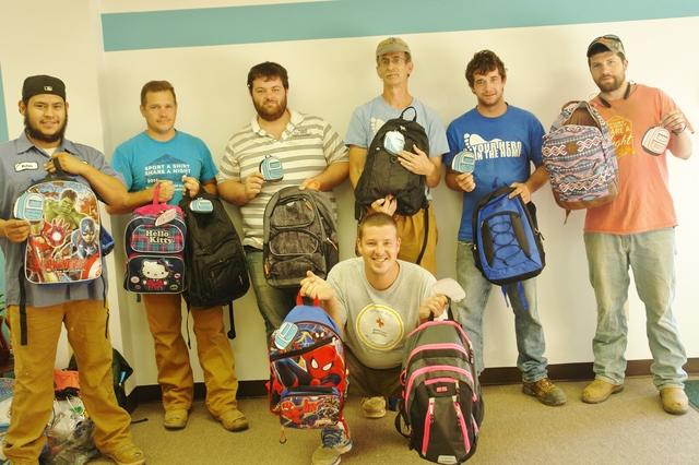 Team Tar Heel with the donated backpacks