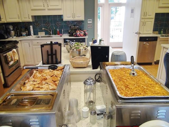 volunteers cook meals for families at the Ronald McDonald House
