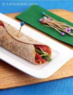 Whole Wheat Salad Wrap, rich in vitamin A, iron, vitamin C and fibre, making a wholesome, satiating breakfast, from left-over chapatis. This dish can be put together quickly, if the hummus has been prepared in advance and refrigerated.