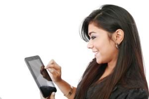 Kozzi-businesswoman-with-electronic-pad-441 X 294
