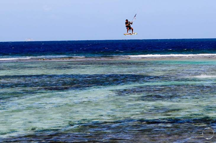 A kite surfer, taking advantage of a strong breeze on Union island.