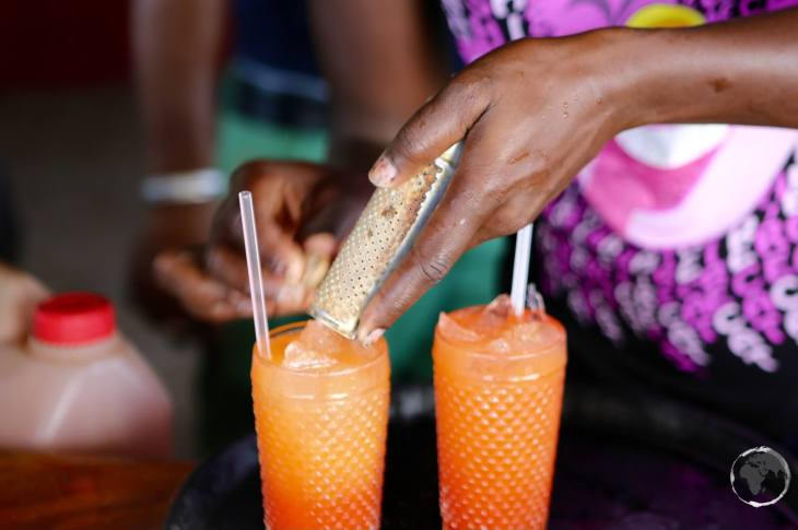 Saint Vincent & the Grenadines Travel Guide: The most popular drink in the Antilles, the 'Rum Punch', being expertly prepared on tiny Happy island.