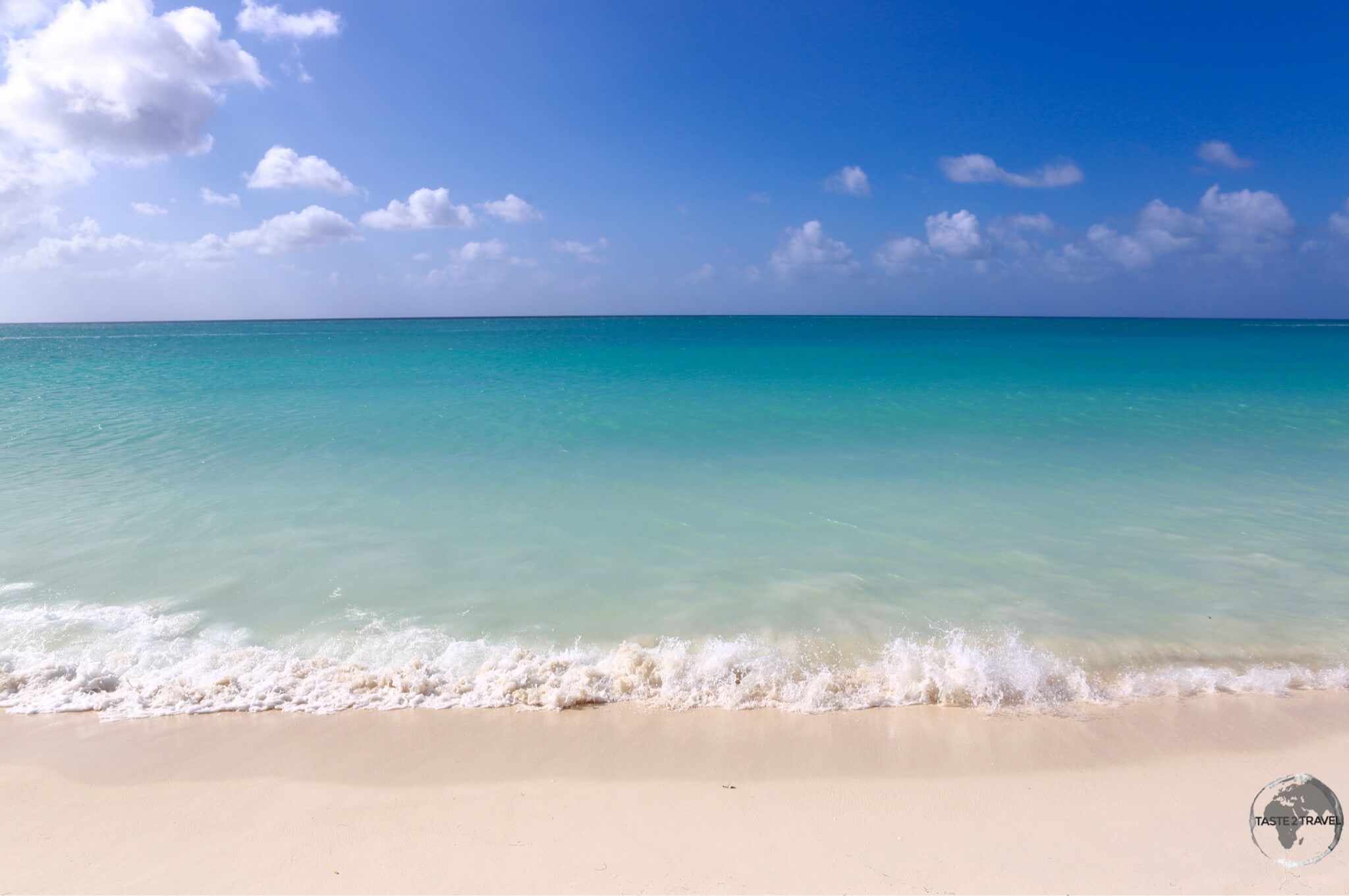 The inviting turquoise waters of Palm beach are a key tourist draw.