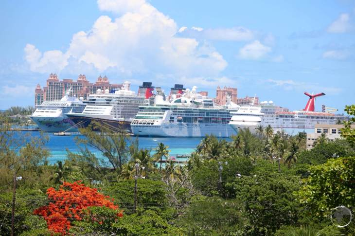 Cruise ships in Nassau harbour with Atlantis resort in the background.