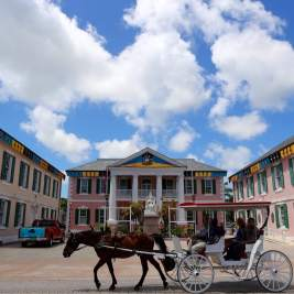 Horse and carriage pass by Parliament Square, Nassau.