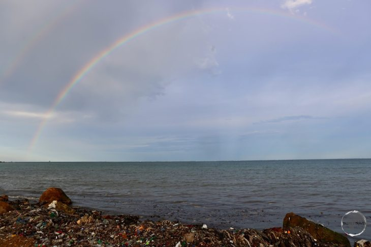 Rainbow over a heavily polluted beach in Cap-Haïtien.
