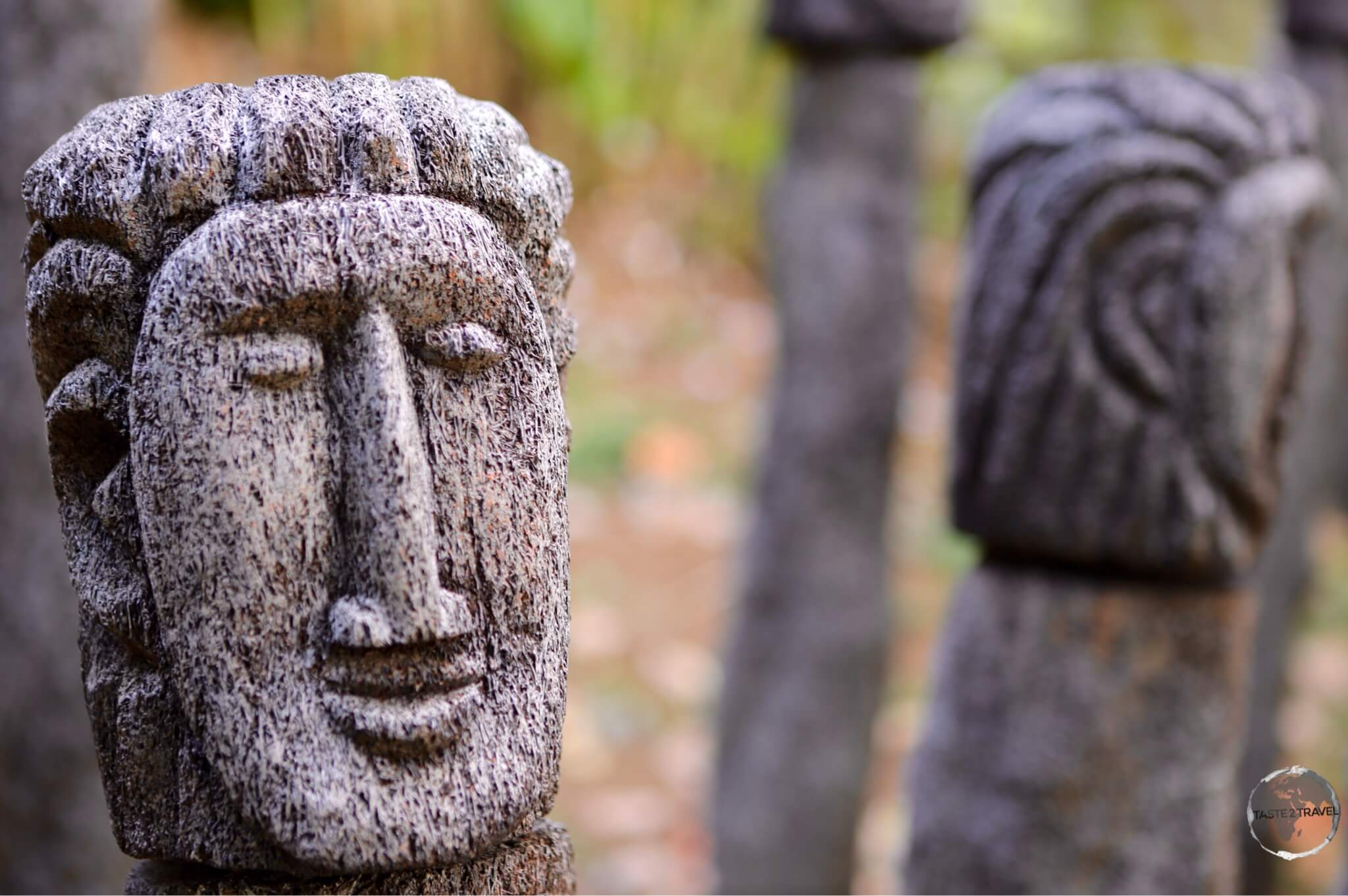 Traditional Kalinago busts carved from tree stumps.