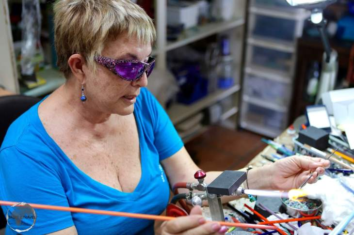 Saba Travel Guide: Jo Bean giving instruction during her glass-bead making class.