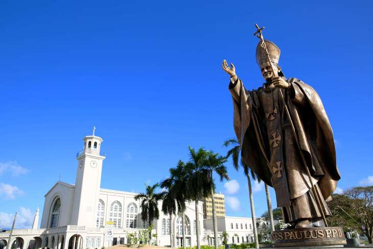 Statue of Pope John Paul II and Dulce Nombre de Maria Cathedral Basilica in Hagåtña