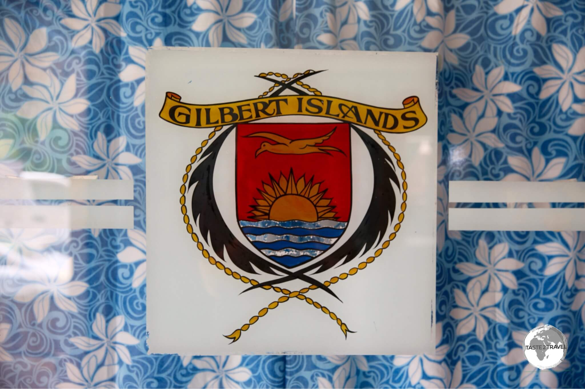 The Gilbert Islands coat of arms, displayed on the window of the General Post Office.