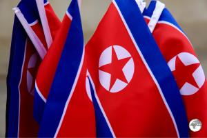 DPRK flags on sale at a souvenir stall.