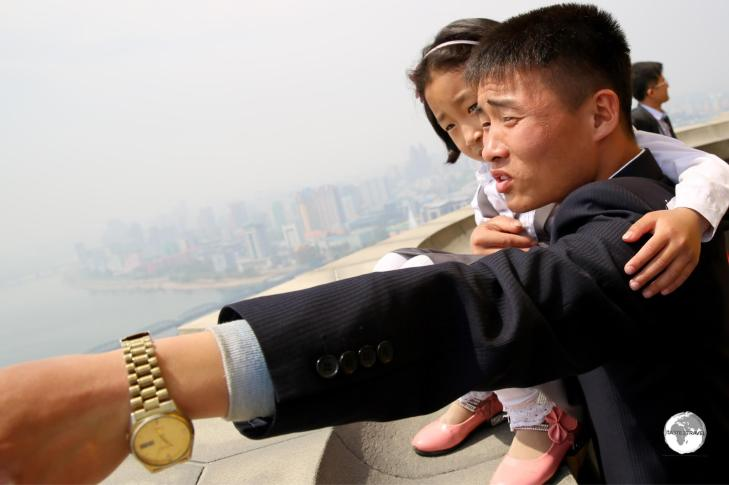 A North Korean family enjoying the panoramic views from the top of the Juche Tower.