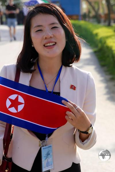 Our wonderfully unflappable KITC guide, holding my souvenir DPRK flag, at Pyongyang Zoo.