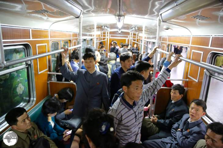 Riding the Pyongyang metro during the morning rush hour, in a carriage full North Korean commuters, who were polite, curious and always keen to offer their seats.