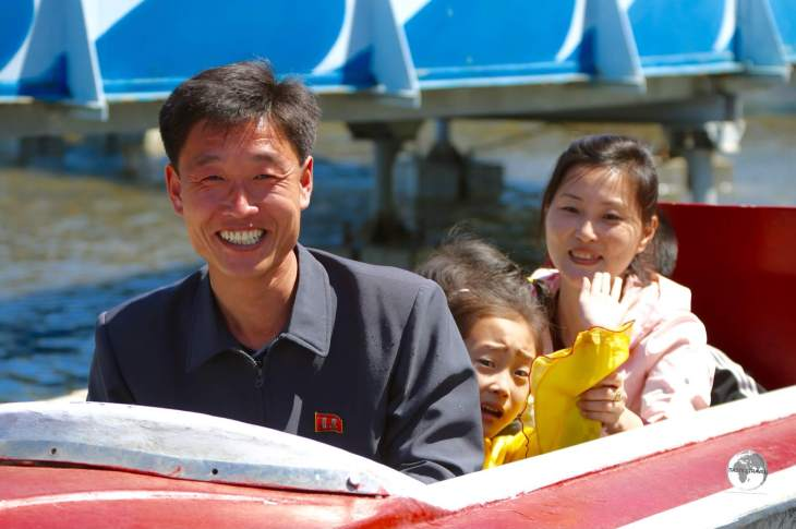 A family enjoying the splash boat ride at Mt Taesong Amusement Park in Pyongyang.