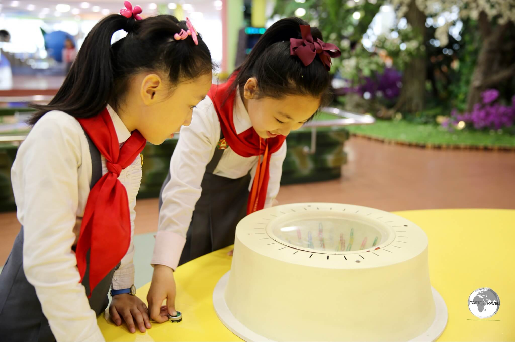 School girls playing with an interactive exhibit at the Science & Technology centre in Pyongyang.