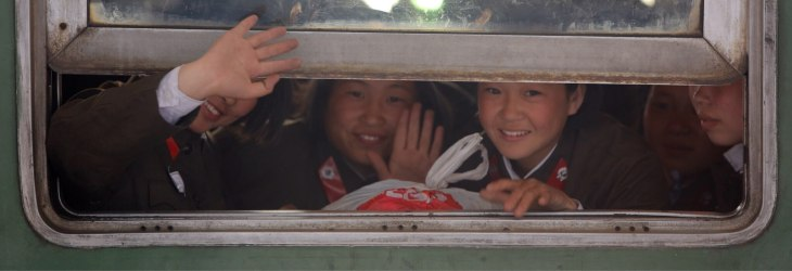 North Korean students waiting to depart on a local train at Pyongyang railway station.