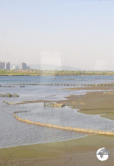 Our first view of North Korea – the banks of the Yalu river with the Chinese city of Dandong in the background.