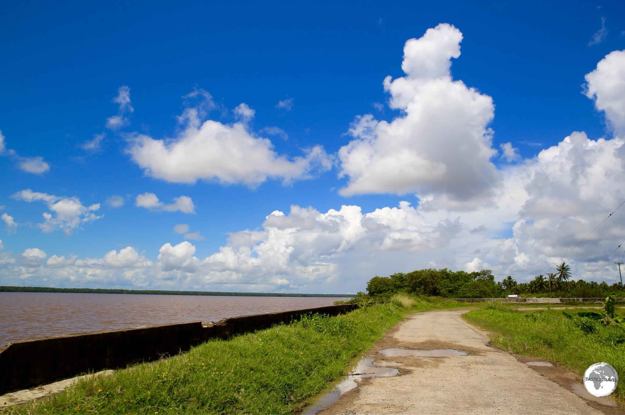 Traveling alongside the seawall of Wakenaam Island with the mighty Essequibo river on the left.