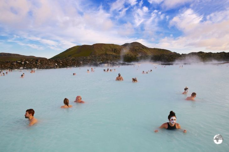 Bathers enjoying the warm, soothing waters of the Blue Lagoon.