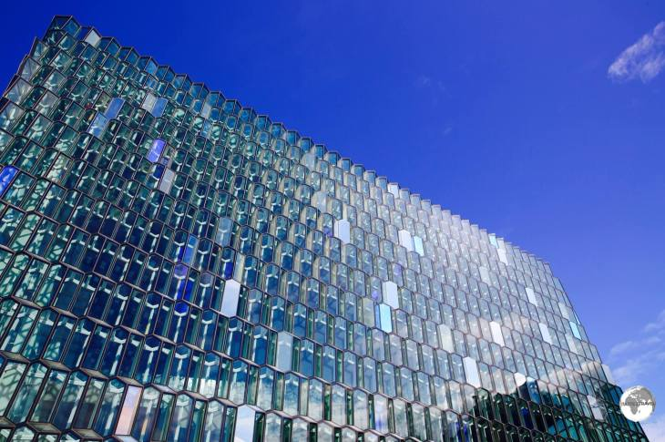The distinctive coloured glass facade of the Harpa concert hall in Reykjavik is inspired by the basalt landscape of Iceland.