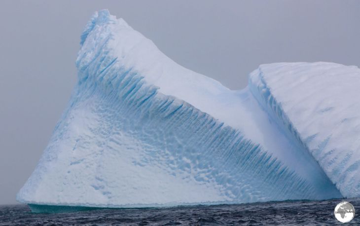 A wind-sculptured Iceberg, sitting in the Neumayer channel at Damoy point.