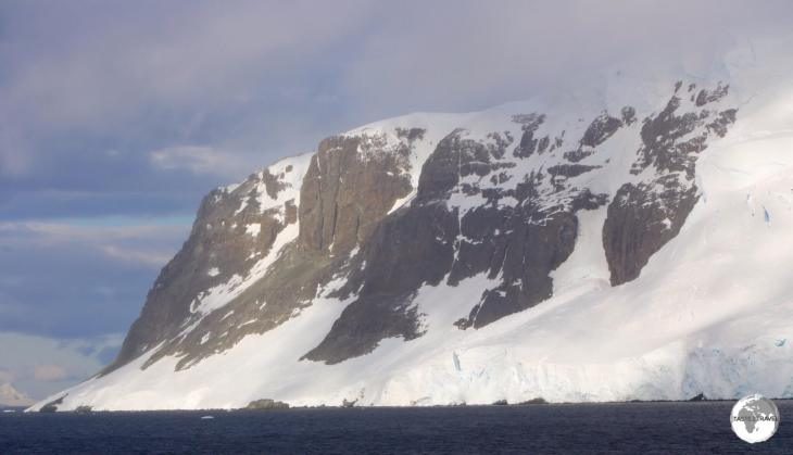 A view of the towering peaks of Graham Land from the narrow Lemaire channel.