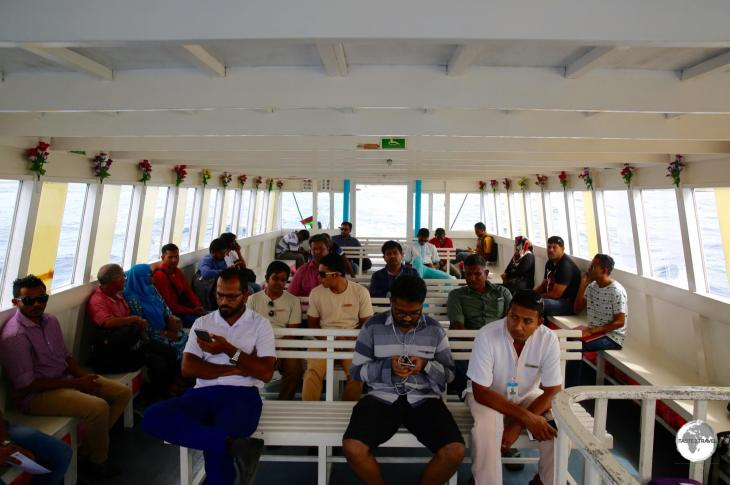 Riding on the airport ferry from the airport to Malé which is a 10-minute crossing.
