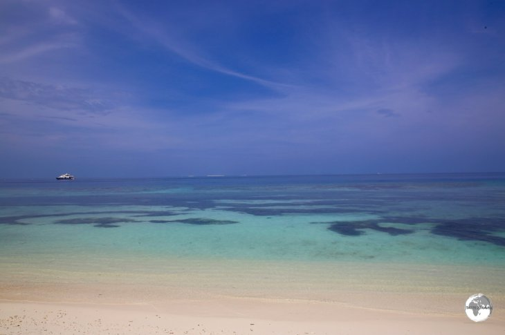 The low-lying islands of the Maldives, such as Maafushi Island, feature white sandy beaches with fringing coral reefs.