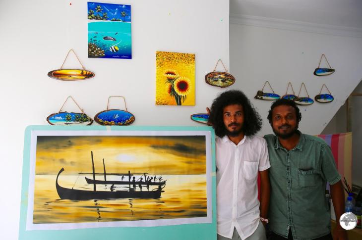 Local artist Ibrahim Shinaz (right) in his studio on Maafushi.