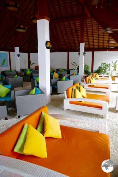 Comfortable lounges line the sand floor of the Sunset Bar at Vilamendhoo Resort.