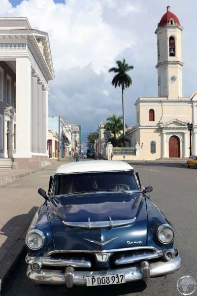 A classic American car parked outside Teatro Terry in downtown Cienfuegos.