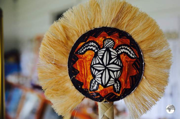 Hand-painted Tapa fans are popular souvenirs.