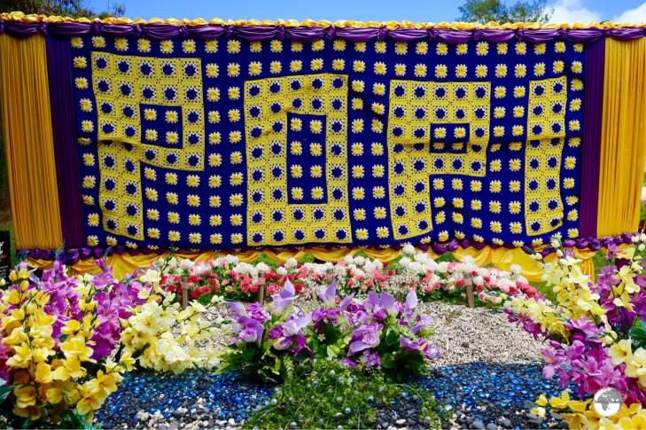This huge grave-site banner is comprised of many small hand-crochet squares.