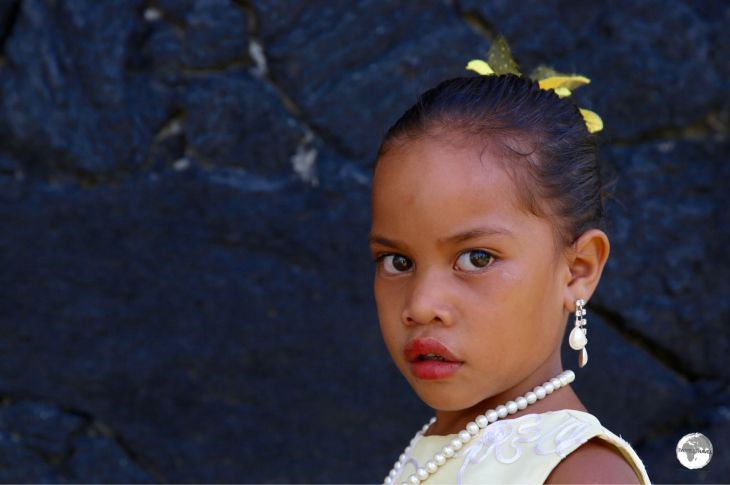 A young girl on 'Eua Island, on her way to church.